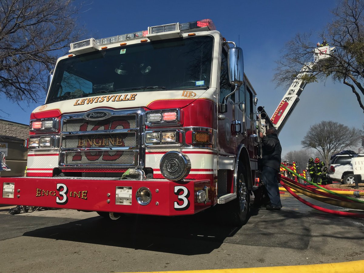 Pictured is Lewisville's 95' Velocity mid-mount aerial platform along with two Lewisville Impel pumpers and Flower Mound's 75' Velocity aluminum ...