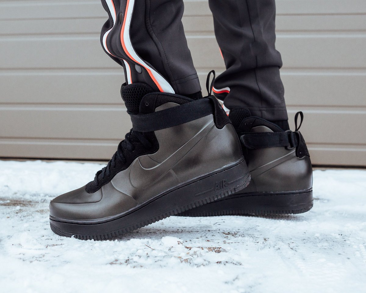 c357edf583f ... classic AF-1 silhouette is fused with the three-mold foamposite  construction this time in a triple black colorway. Limited quantities  available this ...