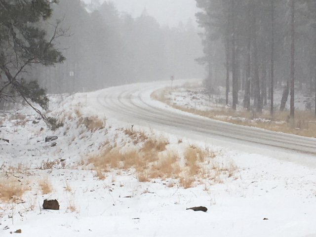 A snowplow works to keep SR 87 clear northeast of Strawberry, milepost 280. #azwx
