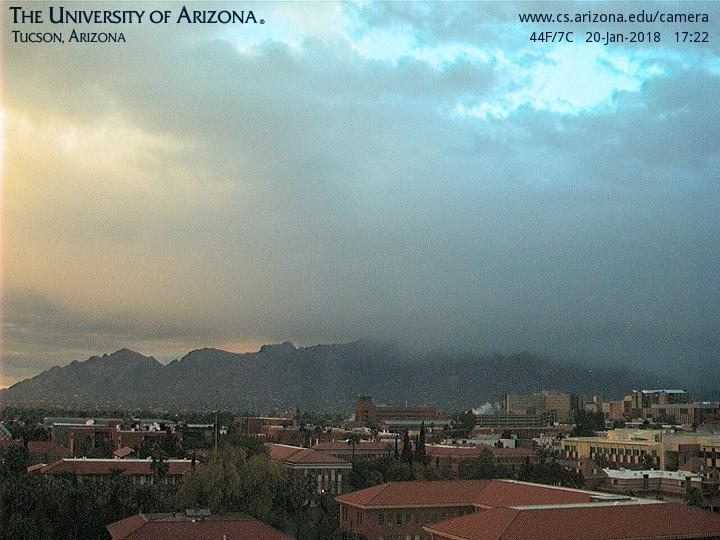 View of the Santa Catalina Mountains looking north across the University of Arizona campus. via UofA cam #azwx
