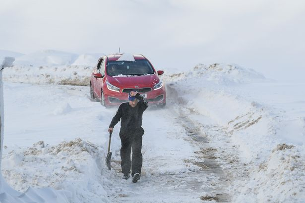 Britain braces itself for more snow and...