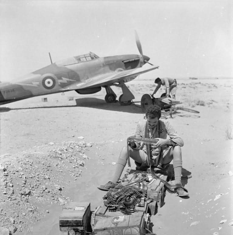 Sgt. Dean of 274 Squadron RAF examines b...