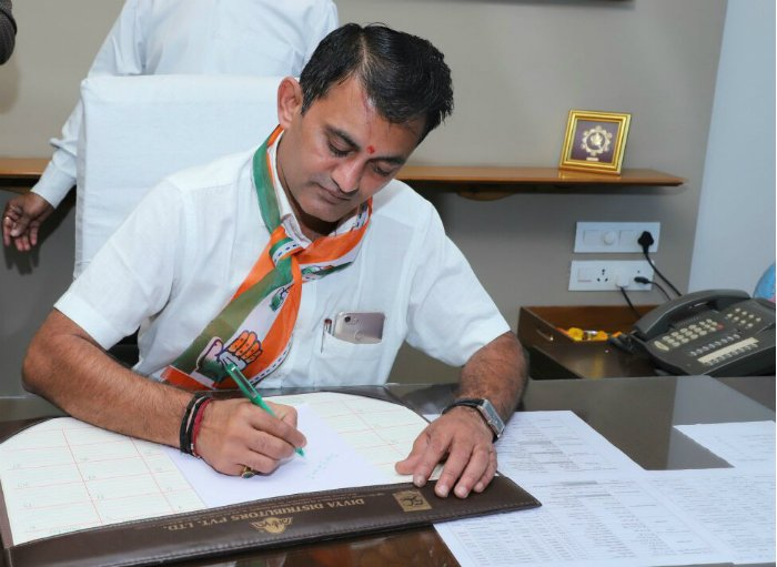 Dhanani takes charge as LoP after performing puja in his office