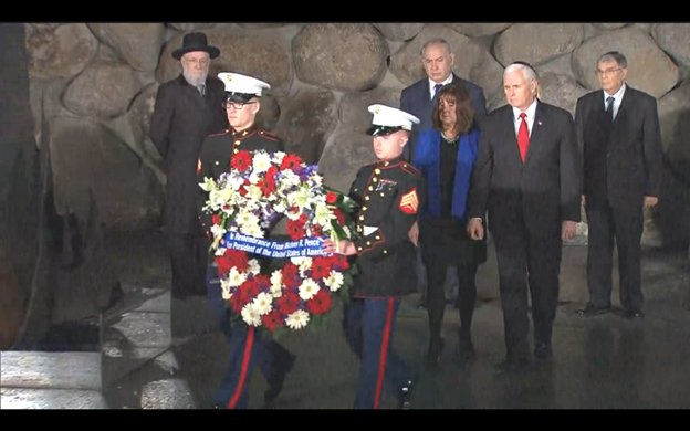 Earlier, with the help of 2 Marines, @VP and Mrs Pence place a wreath at the Eternal Flame at Yad Vashem, Israel's Memorial to the victims of the Holocaust. PM @netanyahu looks on.
