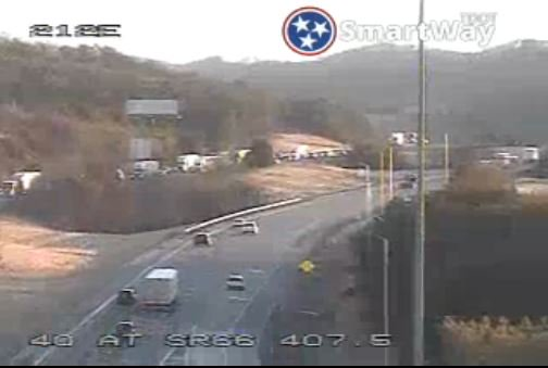 TRAFFIC ALERT: A vehicle fire on Westbound I-40  at MM 406 is slowing/backing up traffic past the Smokies Stadium exit. Est. clear by 8:30 a.m.