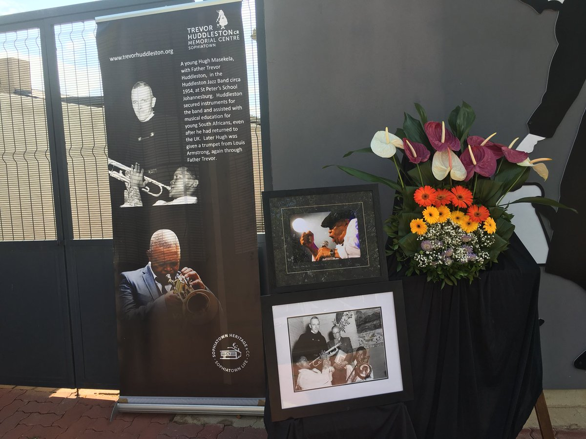 #HughMasekela The Trevor Huddleston Memorial Centre in Sophiatown - established in honor of the man who gave Masekela his first trumpet - has his photos outside as a sign of its respects. HM