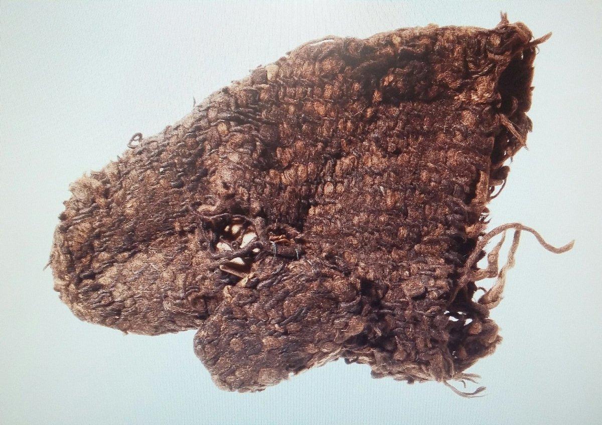 a brown woolen mitten