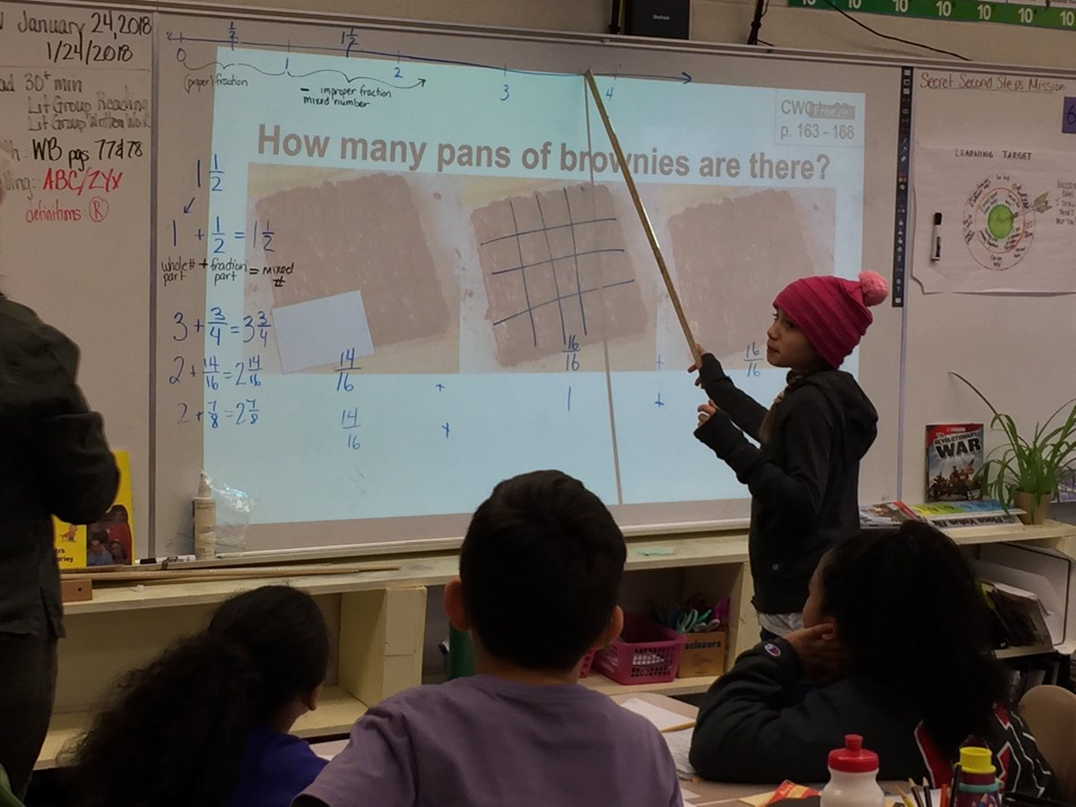 4th grade is explaining fractions using pictures and number lines - students helping students!