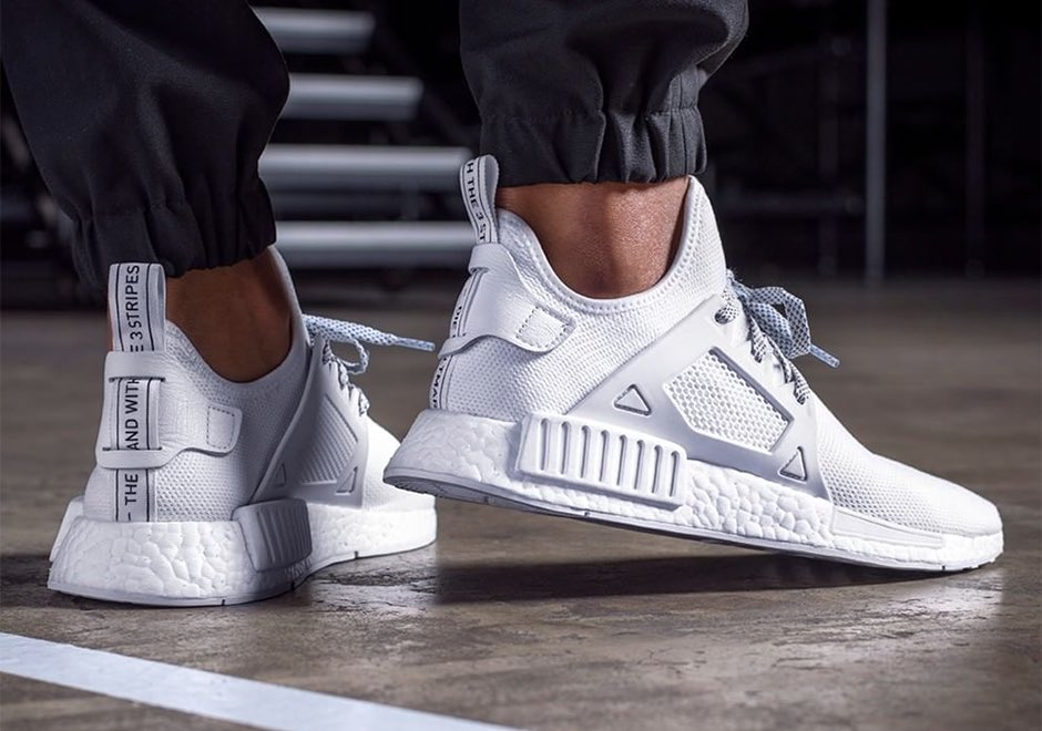de0e51e97 ... Adidas NMD XR1 Triple White. Full tonal white upper and complementing  full white BOOST midsole for a very clean look. Available NOW online and  instore.