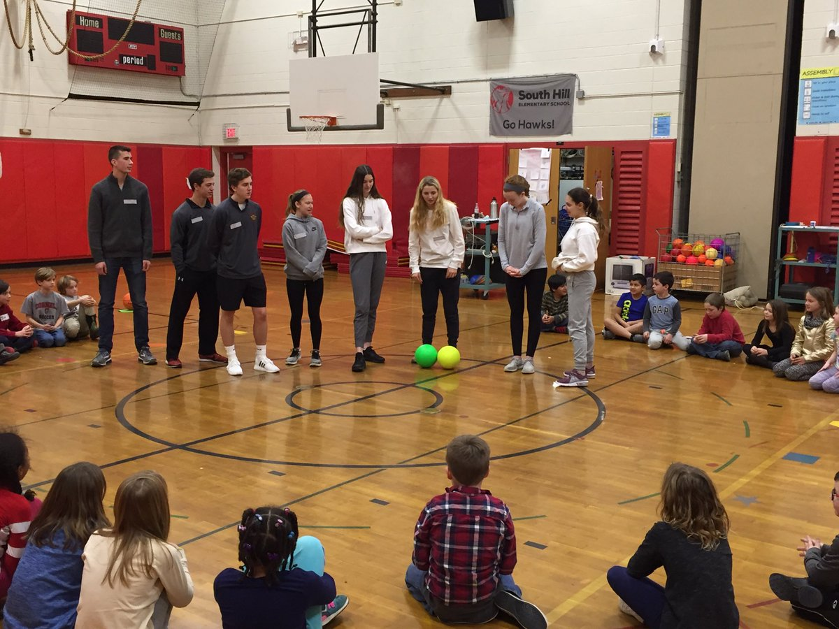 Members of the Ithaca Athletics Captains Council making great use of their time during Regents week teaching elementary students at South Hill about communication and collaboration through play.