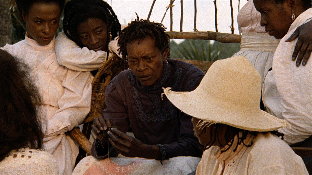"""an analysis of the film daughters of the dust by julie dash Julie dash's """"daughters of the dust"""" chronicles a period of widespread social change through the lens of a single family through dreamy, haunting imagery that emphasizes a timeless landscape of marsh grass, palmetto trees, and pristine beaches, dash's film suggests that despite the changing times, the gullah culture of the sea islands will."""