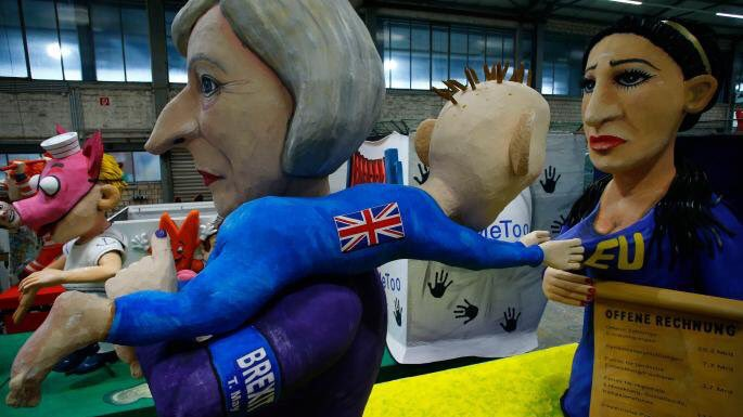 Currently rolling its way through Köln's Rosenmontag parade...  Theresa May, with a Brexit armband, dragging away a screaming baby [] from the EU.  [HT @Simon_Gardner]<br>http://pic.twitter.com/LXM73v690R