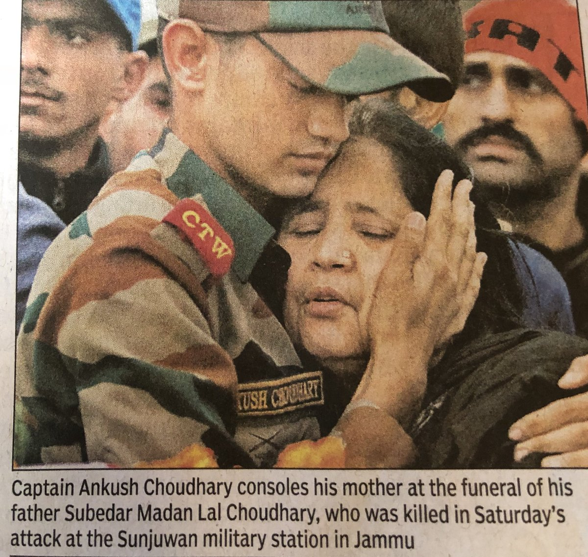 The kind of heart-wrenching photograph we've become all-too accustomed to seeing in the news.But let us pause,even if just for a moment,to acknowledge this mother & son.The son's expression bears witness to the commitment two generations of his family have made to the country