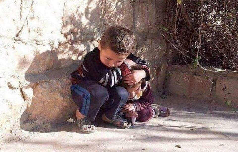IMAGE: Syrian child protecting his younger sister amid airstrikes. https://t.co/hCr0bkM6No