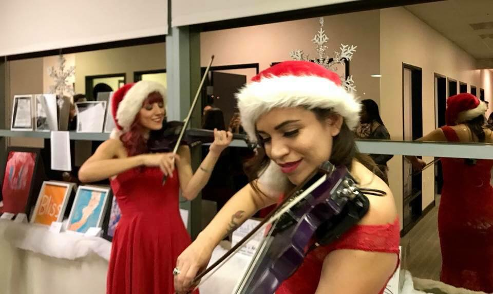 Image result for violinist at christmas party