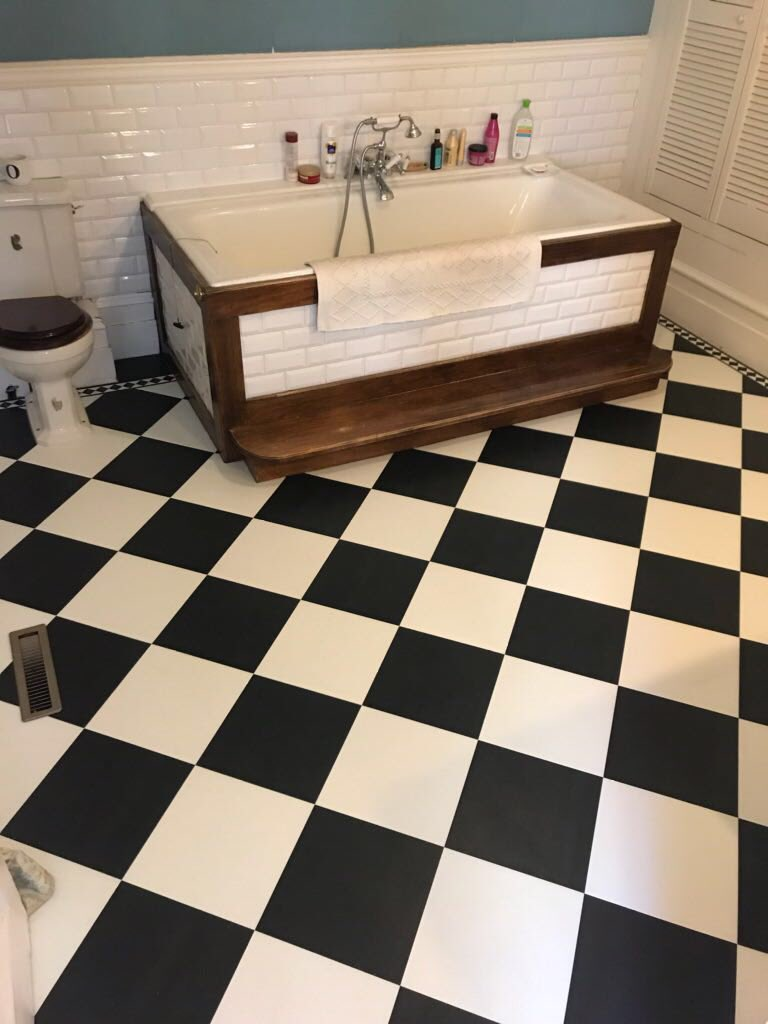 Classic black and white checkerboard installation for a timeless look. We added a border for a completely bespoke design, which is one of the MANY benefits of a @AmticoFlooring floor!