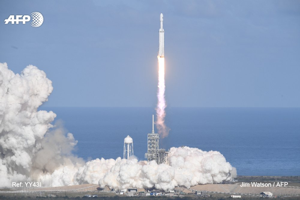 World's biggest rocket soars toward Mars after perfect launch  #FalconHeavy