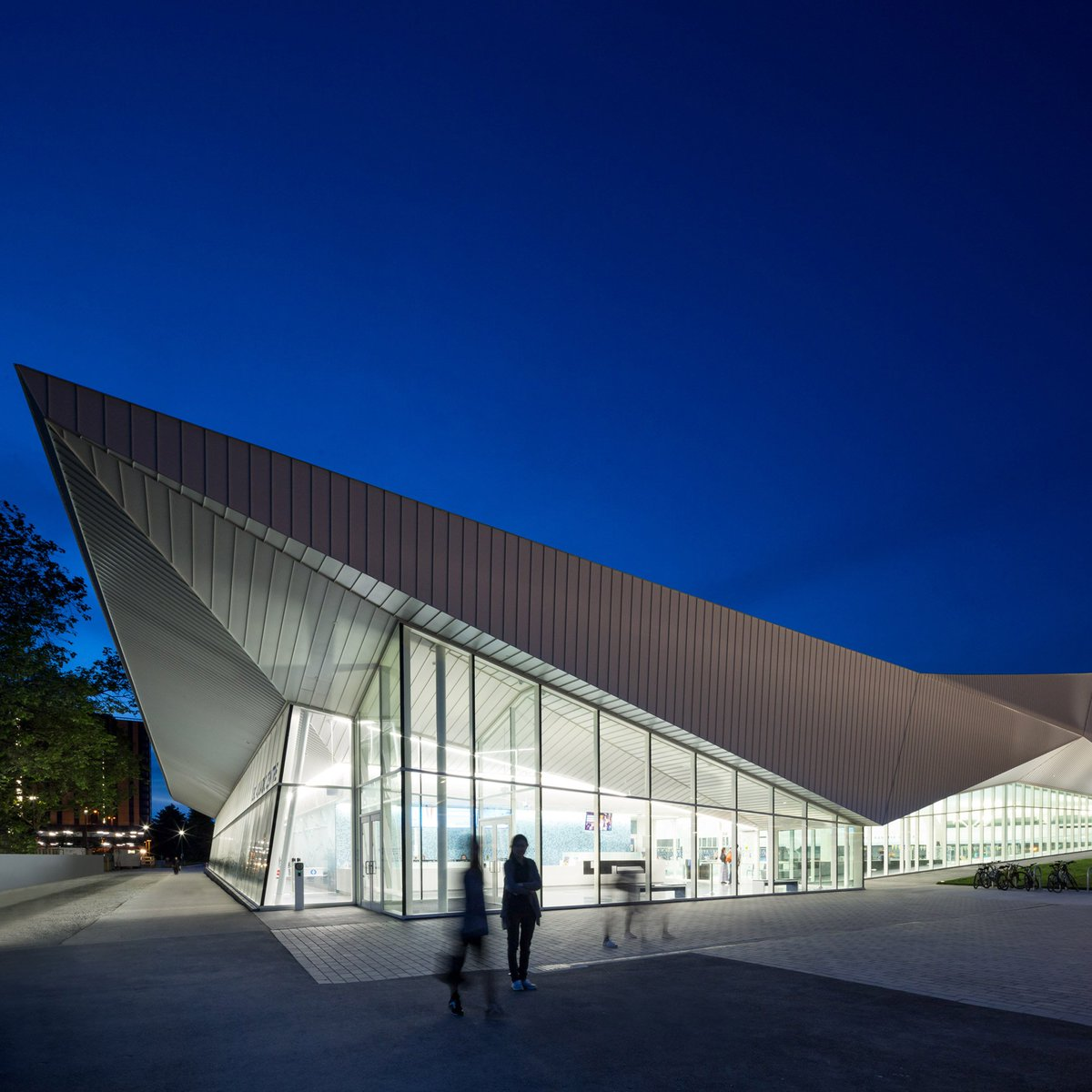 Angular white roof covers mjma 39 s glazed aquatic centre in for Pool design vancouver