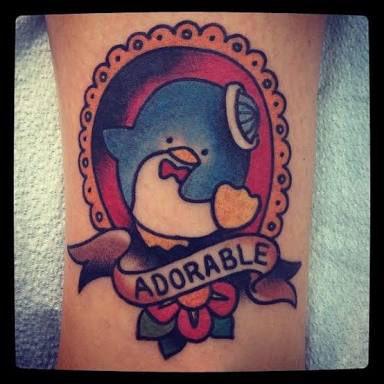 タキシードサムの絵に「ADORABLE(愛らしい)」とだけ書いたタトゥーを自分の身体に入れた人、たぶんメチャメチャいい人だろうな