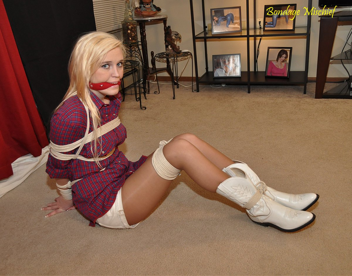 The beautiful blond girl tied with rope stock image