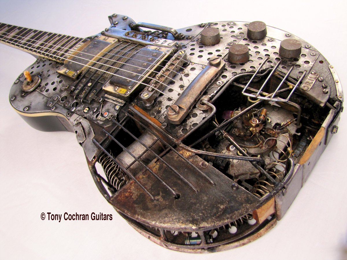 #Steampunk-ish Awesome of the Day: Industrial Drill Electric #Guitar Customized with Weathered Aluminum, Steel Rod, Savage Vintage Circuitry by @TCochranGuitars #SamaGuitars