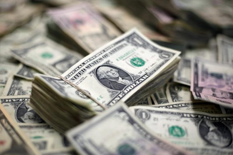 Dollar falls to three-year low, yen shru...