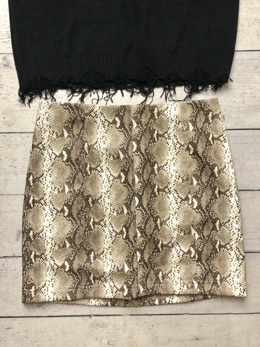 8674f5722 https://shopleapoffaith.com/collections/featured-collection/products/ snakeskin-mini-skirt?variant=5068371623977 …pic.twitter.com/0vnuJkILwM