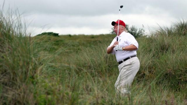 Trump says he is skipping golf to honor...