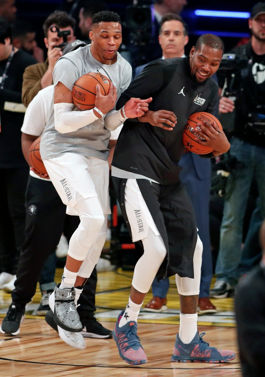 6fa00a8f57ab Team LeBron s Russell Westbrook and Kevin Durant joke around before  NBA ·   AllStarGame at Staples Center in  LosAngeles