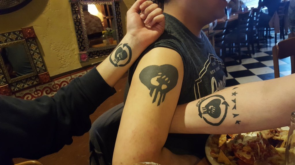 Rise against logo tattoo