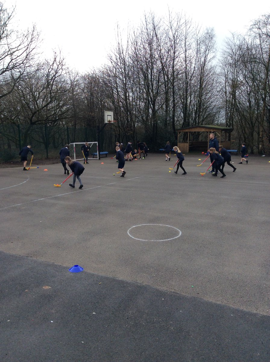 Year 5 starting the half term off learning how to dribble in hockey.