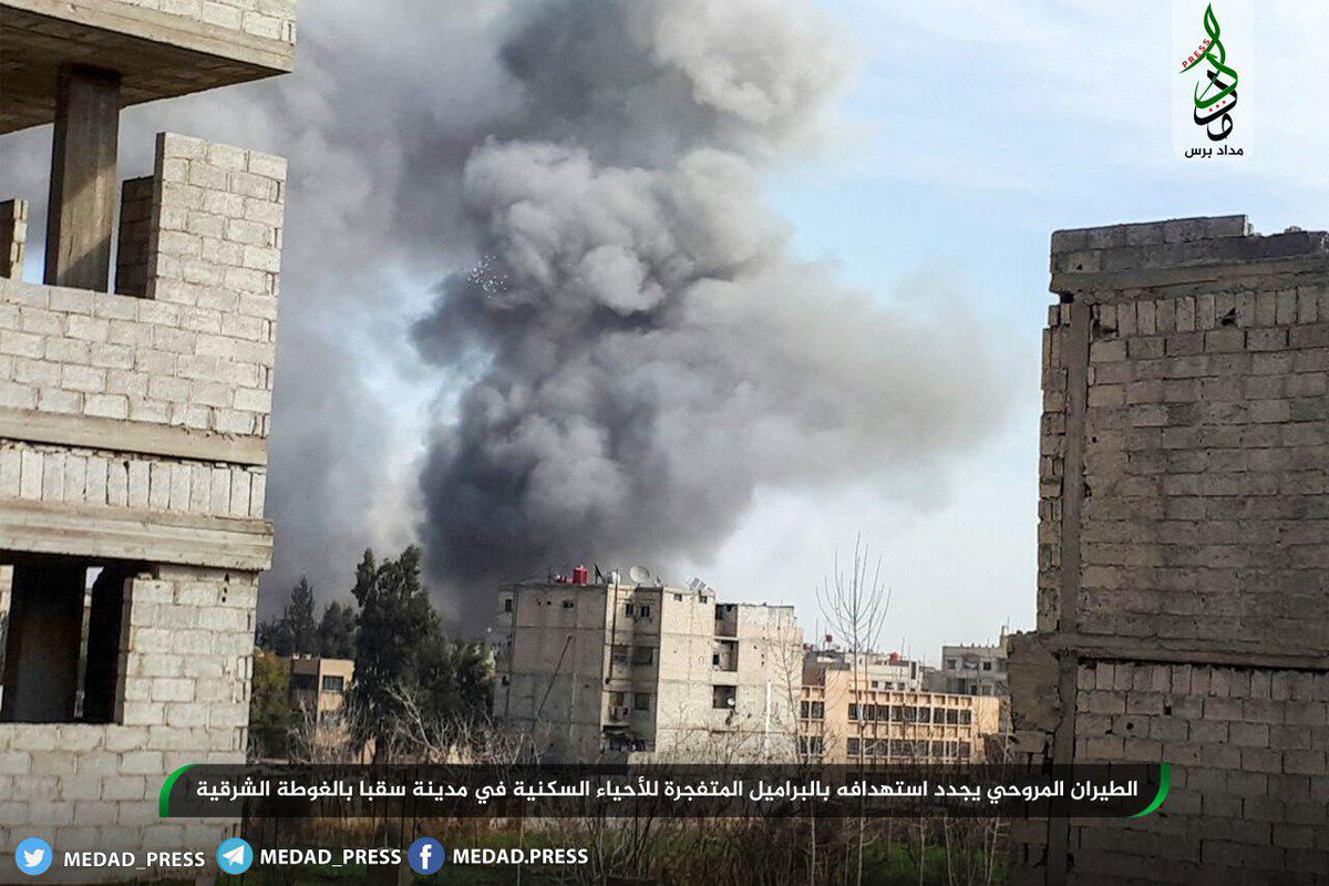 Pics showing airstrikes on E. Ghouta towns and also bombs with  parachute, dropped from helicopters on Sabqa.
