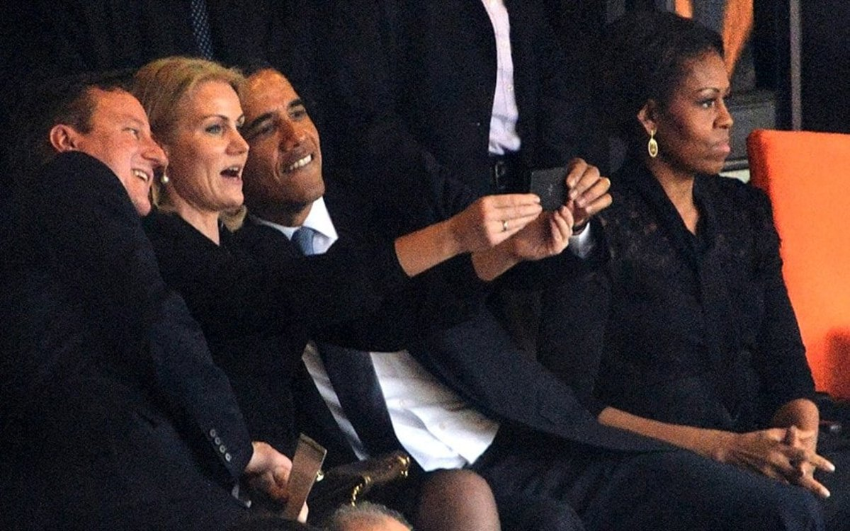Here is Barack Obama at Nelson Mandela's...