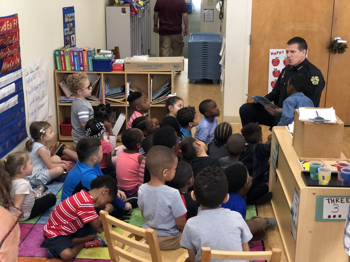 At the Orlando Day Nursery, @ChiefJohnMina reads to the kids as part of our Books and Badges program!