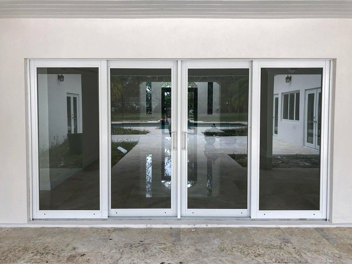 ... impact-resistant #Windows and Doors project in #Pinecrest FL. The picture features sliding glass #doors in clear anodized finish with clear #glass ... & Astor Impact Windows (@astorwindows)   Twitter