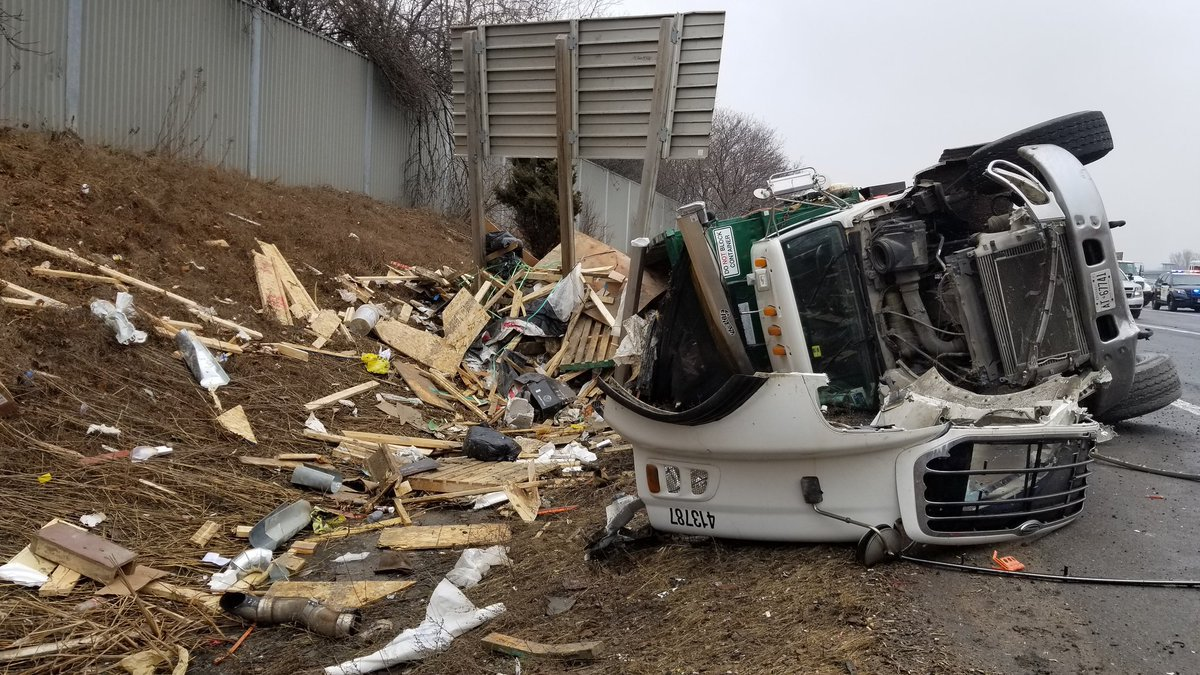 Garbage truck rollover snarls Hwy  401 traffic @SonnySubra