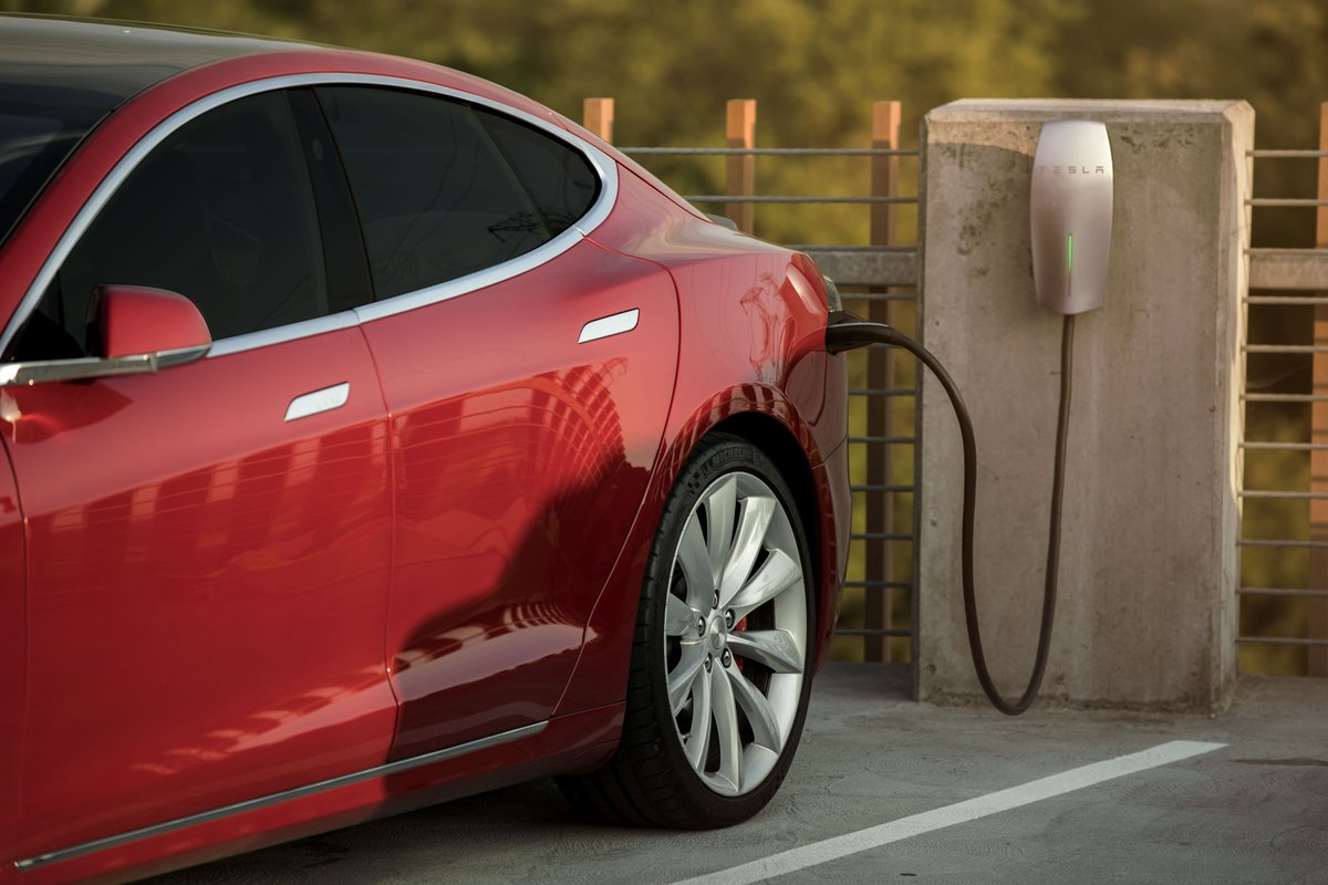 tesla will supply free charging stations to office parking lots. Black Bedroom Furniture Sets. Home Design Ideas