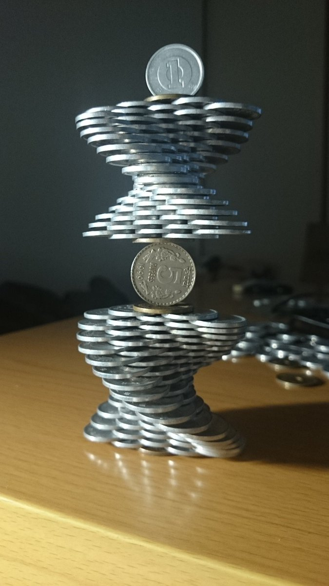 Gravity-Defying Coin Stacking by Japanese Man With Incredibly Steady Hands