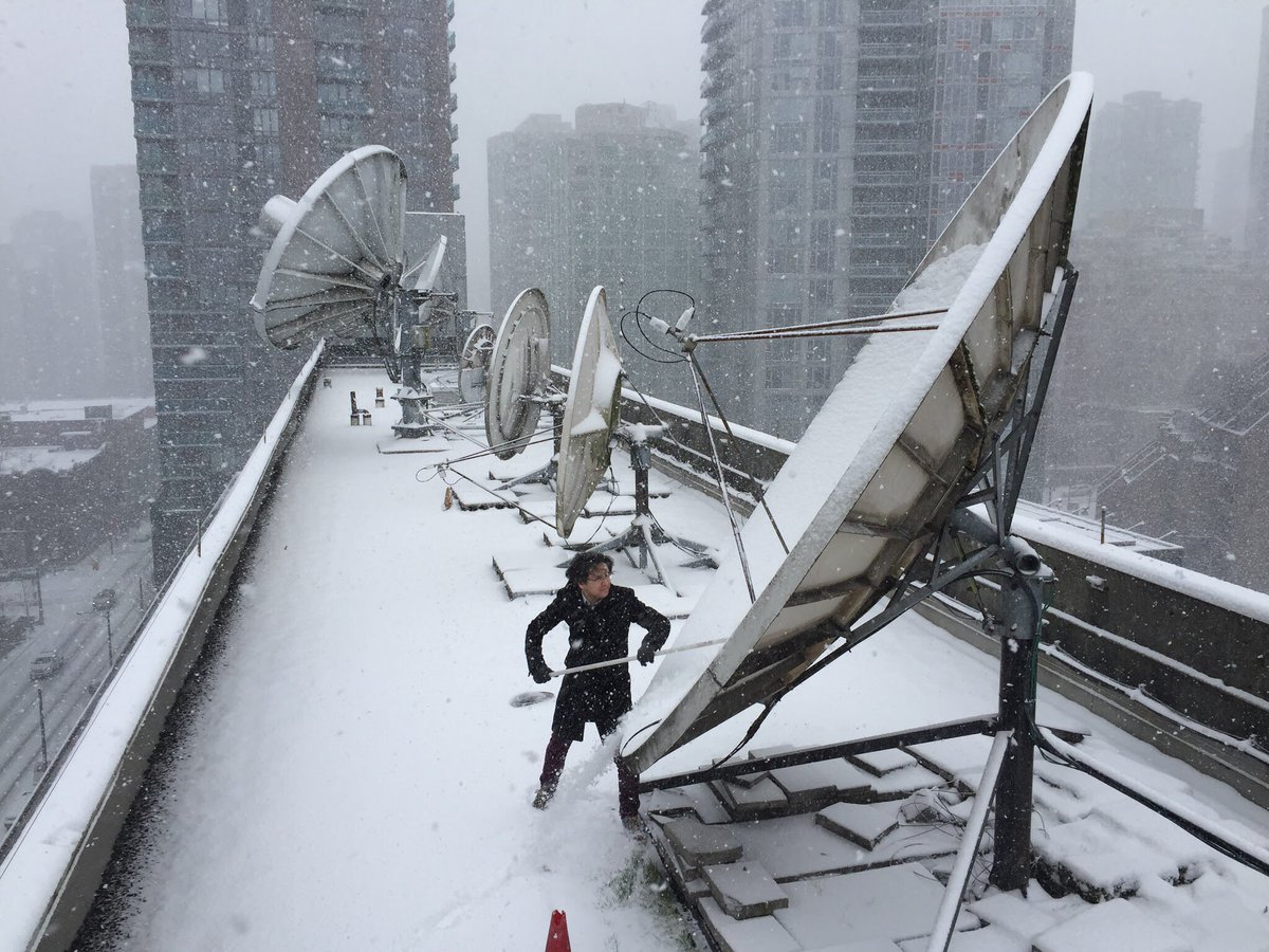 Johanna wagstaffe on twitter snow clearing continues on the roof of cbcvancouver with our hero mike tanaka bcstorm