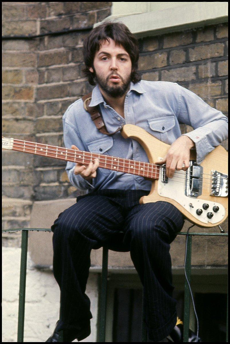 Paul playing guitar at home in London. Photo by Linda McCartney #FlashbackFriday