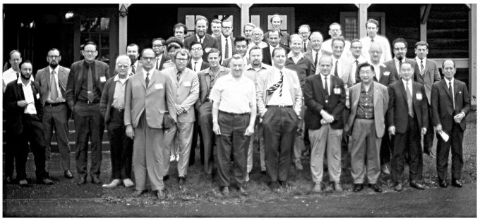 An unnamed woman, mostly hidden, among a group of men at a 1971 International Conference on the Biology of Whales, Skyland.