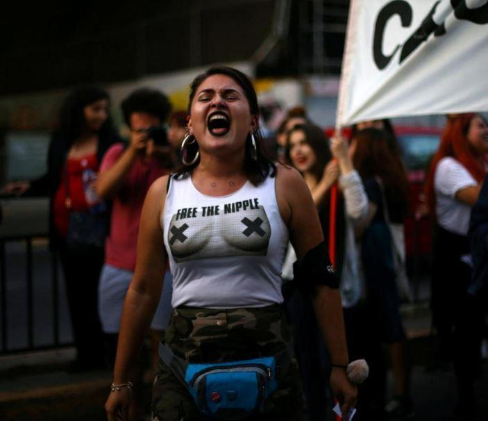 Powerful images show chilean women stripping naked to protest violence against them