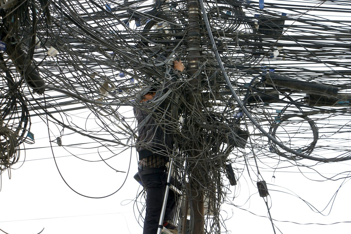 The Kathmandu Post Pa Twitter Too Messy To Fix A Technician Tries To Fix The Lines At A Tangled Mesh Of Wires In A Pole In Pulchok Lalitpur On Tuesday This Kind