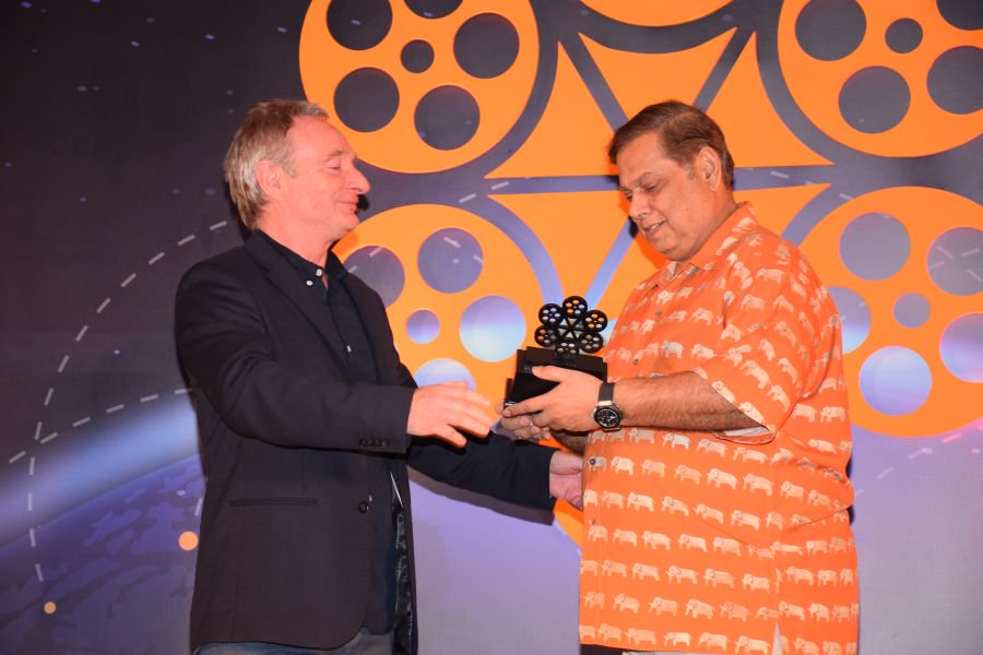 #DavidDhawan wins an award for his &#39;Outstanding Contribution to Indian Cinema&#39; at the 6th #IIFTC TOURISM IMPACT AWARDS 2018 as part of the ongoing India International Film Tourism Conclave @AartiIyerShah<br>http://pic.twitter.com/UpP3ATYpY6