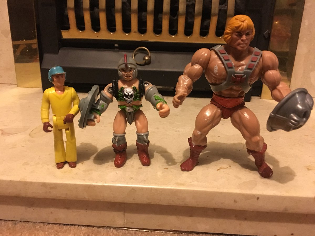 A fisher price figure next to a slightly bigger fantasy action figure next to a much bigger he-man figure.