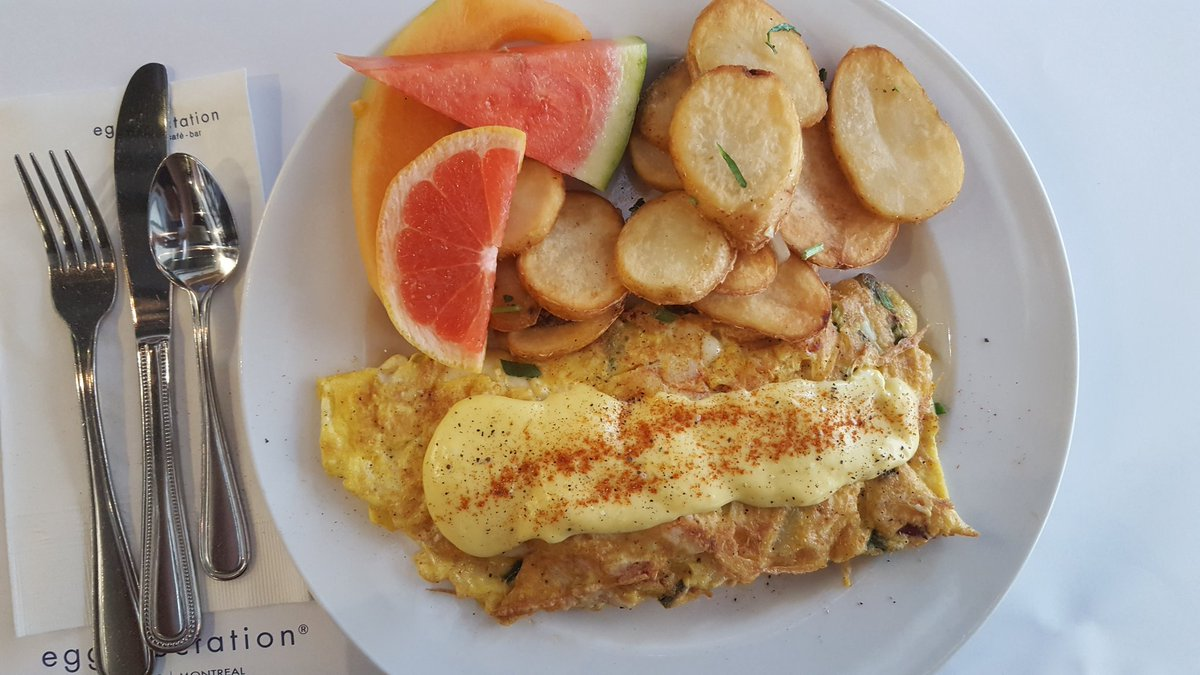 Lobster omelette covered with their housemade hollandaise sauce sliced potatoes with fruit