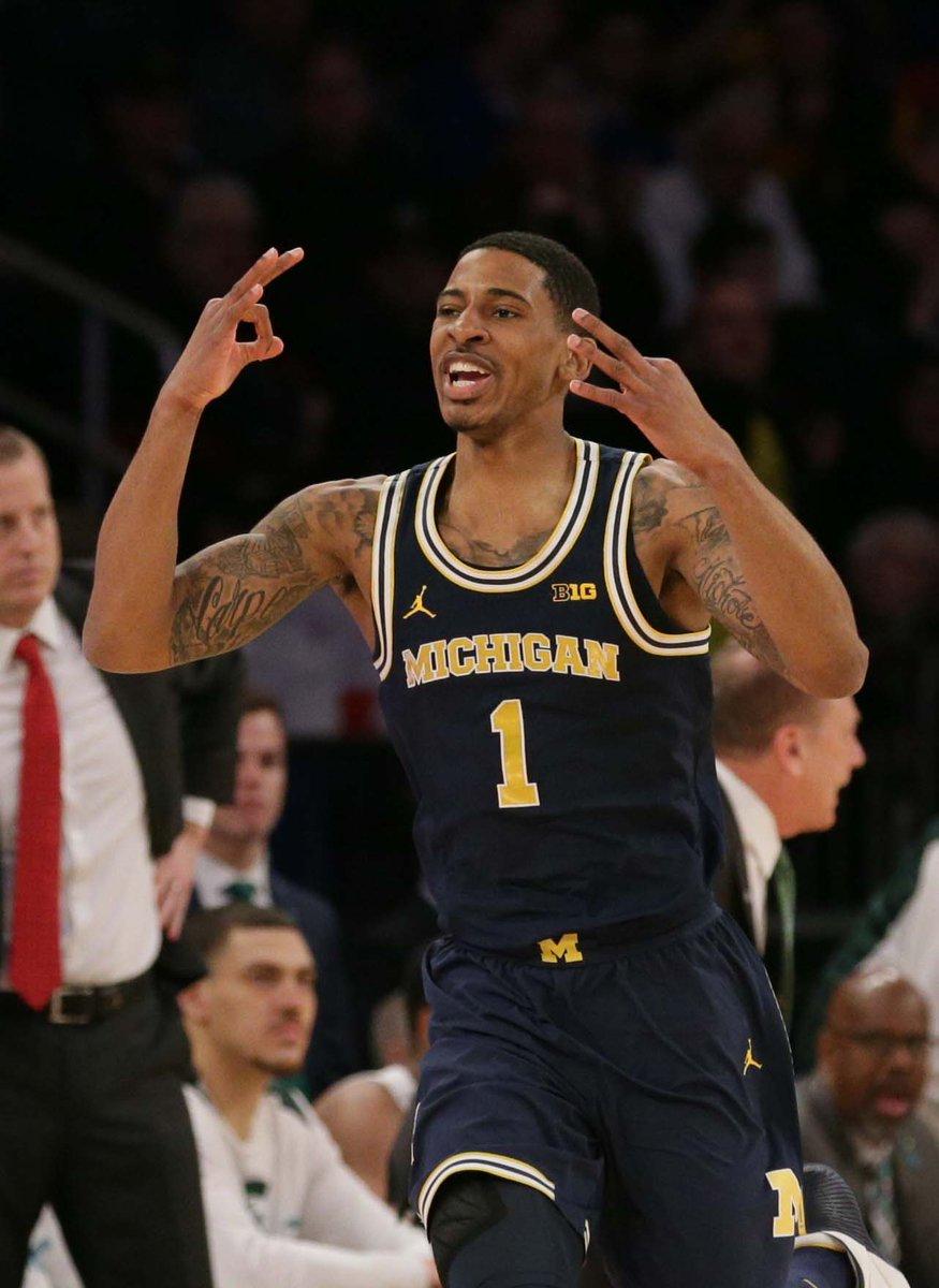 No. 15 Michigan knocks out No. 2 Michigan State in the Big Ten tourney semifinals