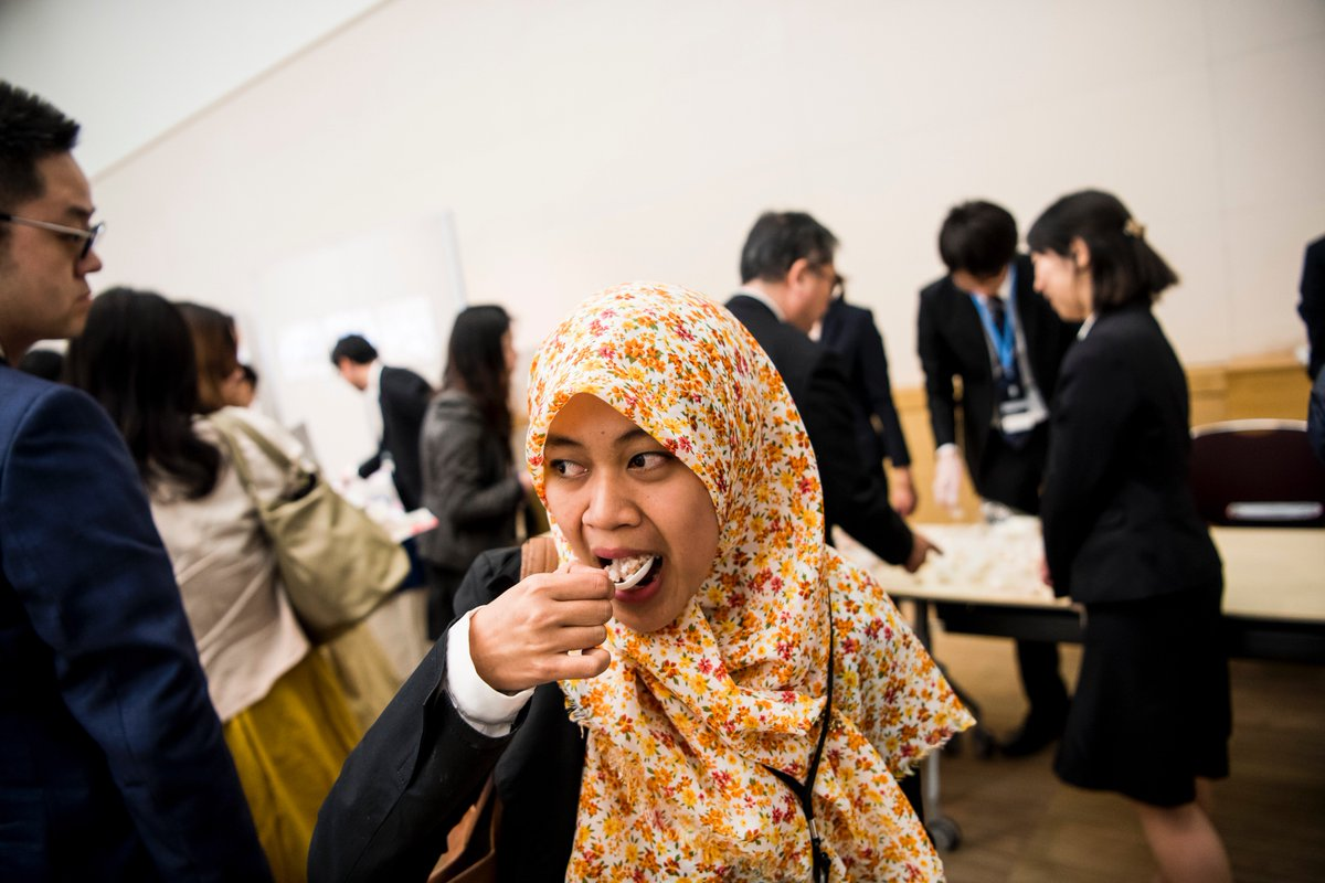 Fauzin Naimah, student in material science, tastes space food served at the Nobel Prize Dialogue Tokyo. This day has given me new insights on food from an anthropology perspective.  Which food she would like to bring with her to space? Tempura!  Photo: Alexander Mahmoud.