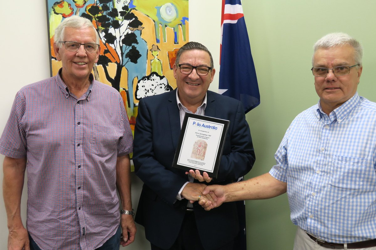 PA Board Members, Brett Howard (right) and Peter Wierenga (left), from Polio SA, presenting @stevegeorganas MP with his 'Parliamentary Patron' plaque from Polio Australia.