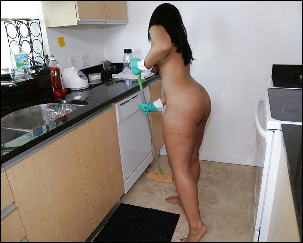 Naturist male nude doing housework
